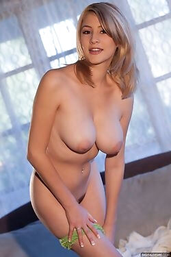 This mesmerizing blonde honey slowly gets naked, baring her breasts, ass and pussy