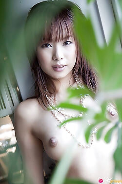 This pretty asian beauty strips naked, flaunting her tits, ass and furry pussy