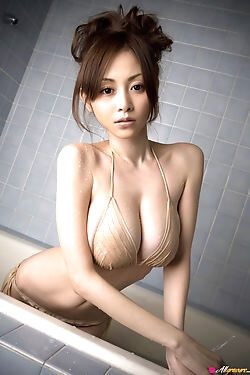 Lovely Asian beauty that's getting soaked in the shower
