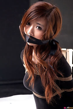 This Asian babe enjoys shibari and gets trussed up and gagged for the camera
