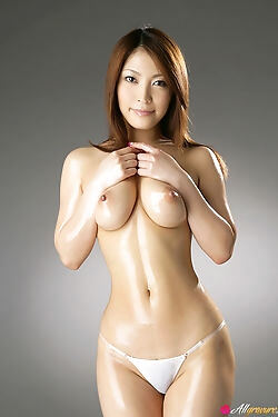 This Asian beauty with hairy pussy shows off her nude and oiled up body
