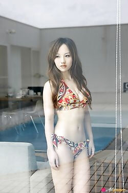 Asian hottie is looking sexy in her bikini and dress