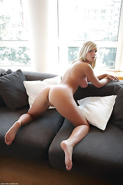 This blonde bombshell shows off her perfect breasts, plump ass and shaved pink pussy