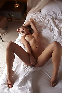 This blonde rolls around on her rumpled bed as she bares her tits, little ass and sweet pussy