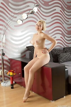 Lovely blonde strips out of her colorful halter dress for your viewing pleasure