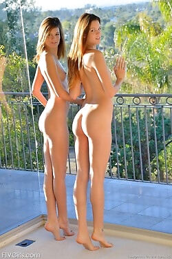 These twin sisters show off their naked bodies and masturbate next to each other