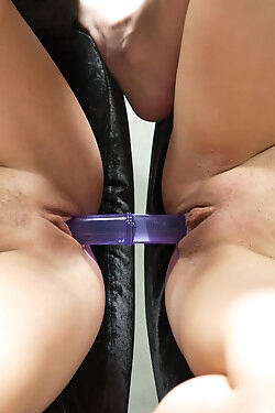 Two randy blondes toy fuck each others' cunts with a double ended dildo