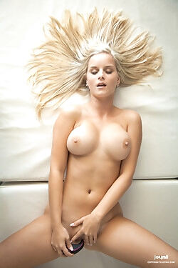 This busty blonde beauty strips naked and toy fucks her soft pink pussy