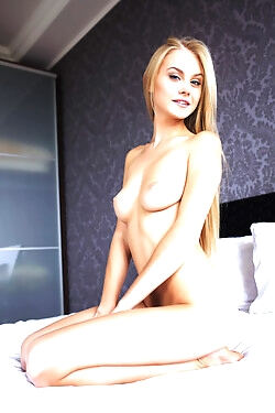 This alluring blonde honey unashamedly shows her perfect tits, ass and shaved pussy