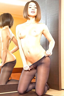 She gets out of her pantyhose and displays her nude figure