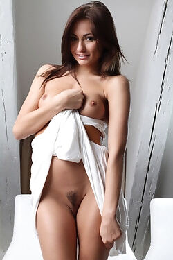 She strips out of her white dress and shows her shapely body