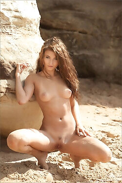 The alluring girl gets naked and covered in sand while she strips on the beach today