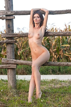 She is modeling outdoors and stripping out of her daisy dukes