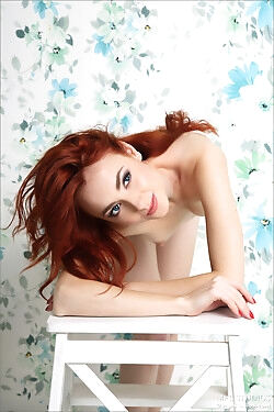 This drool-worthy redhead sheds her clothes and shows off her alabaster skin