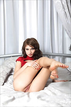 The beautiful doll slowly strips out of her sexy red bodysuit today