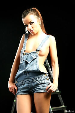 This babe sheds her denim overall shorts, showing off her perky tits, hot ass and sweet cunt