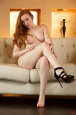 This naughty ginger babe uses a glass dildo to stimulate her pink twat to orgasm
