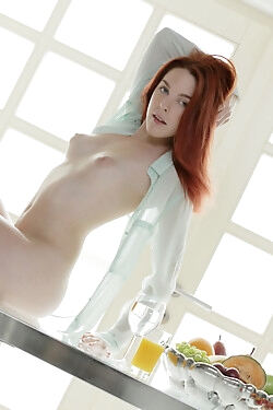 This alluring redhead forgoes breakfast to display her tantalizing curves today