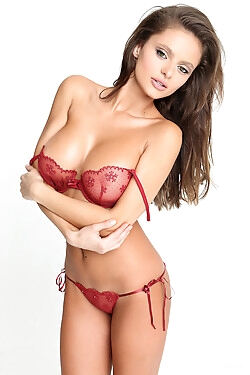 She sheds her sexy red lingerie set and shows her gorgeous body