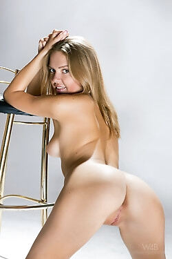 This blonde cutie strips naked and shamelessly shows off her nude body