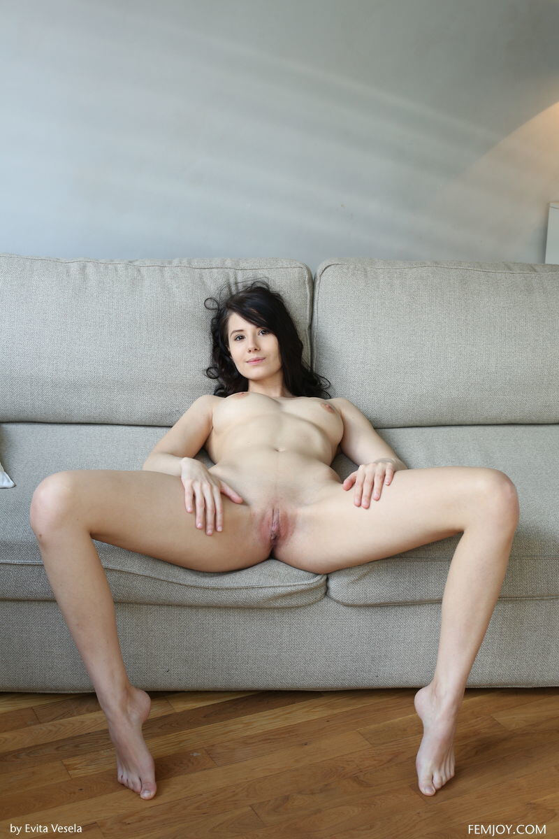 Erotic photos with Vanessa A: Erotica with brunette on a sofa