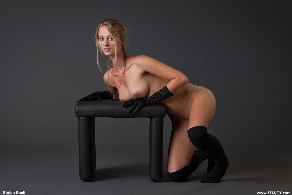 Erotic photos with Carisha: Hot young blonde in black gloves