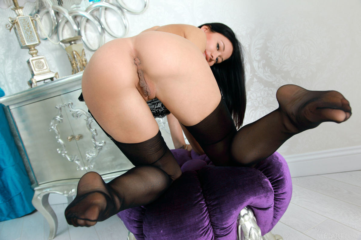 Erotic photos with Mila M: Naughty brunette in black stockings