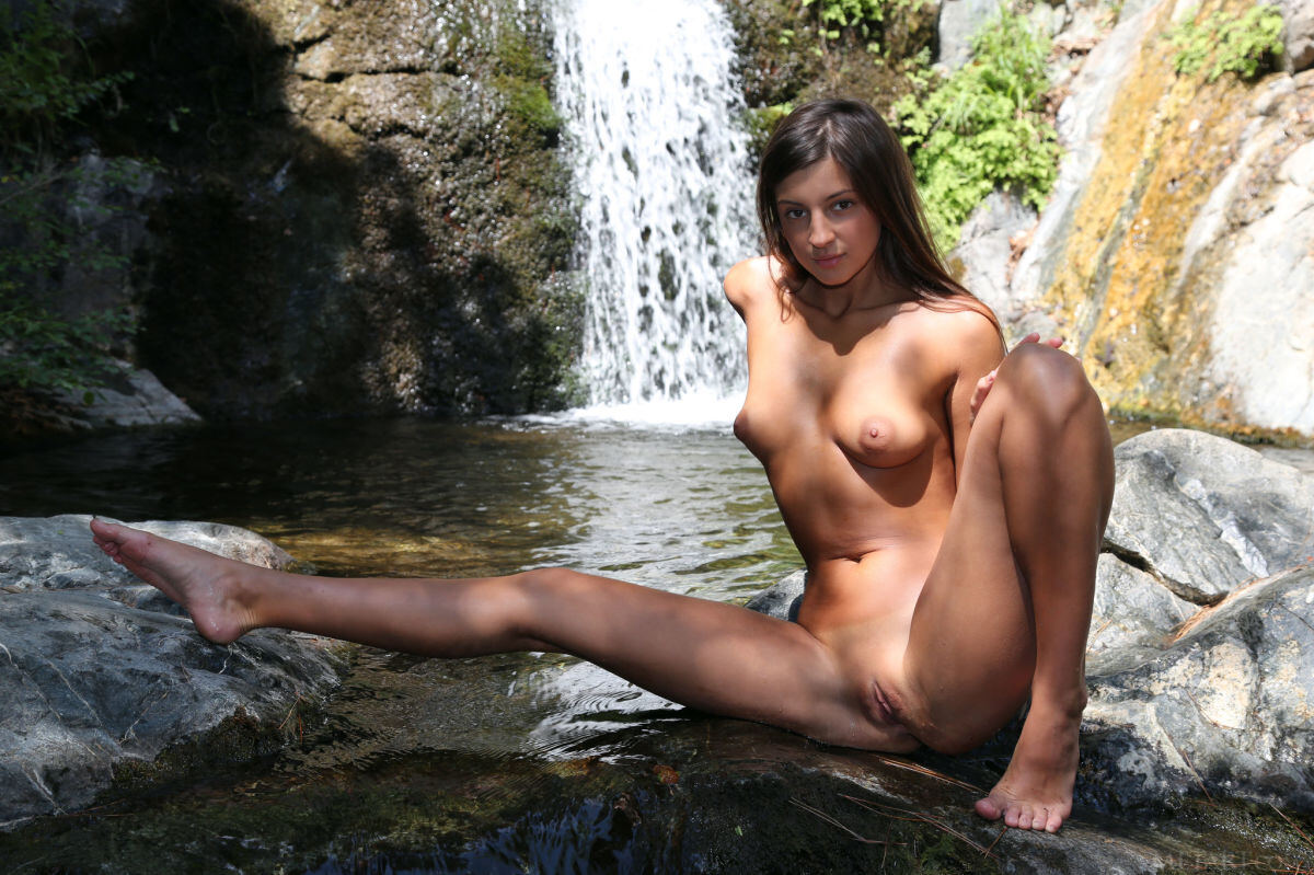 Erotic photos with Malena A: Wet babe and waterfall