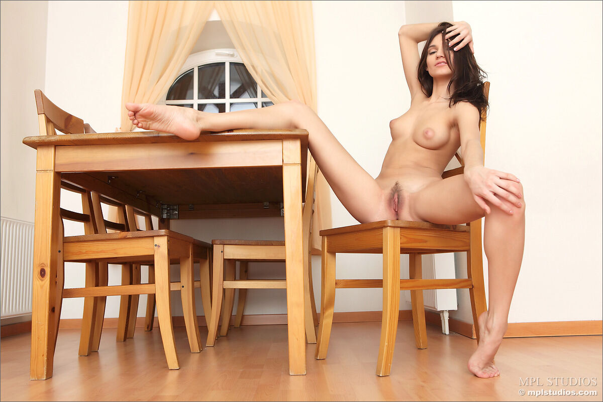 Erotic photos with Mira: On the table