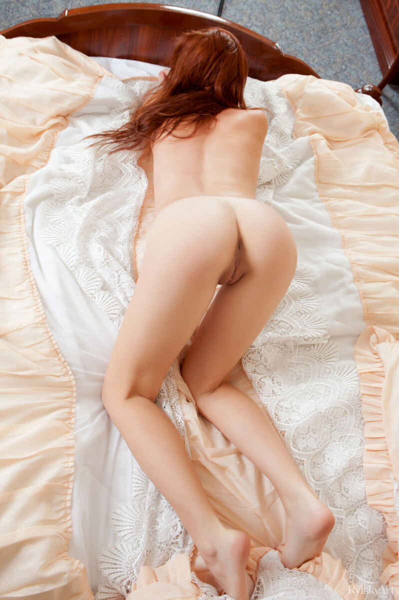 Erotic photos with Solana: Sexy redhead on a bed