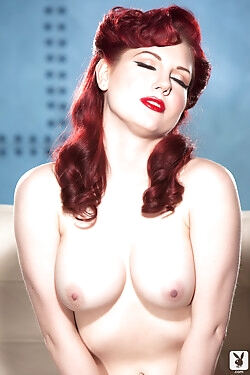 Looking every inch the pin-up girl, this stunning redhead strips all the way naked today