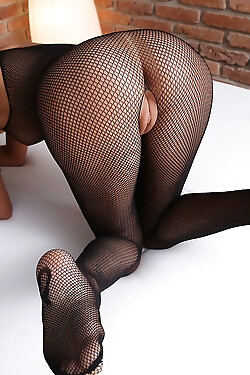 This girl shows off her body clad in crotchless black fishnet pantyhose today