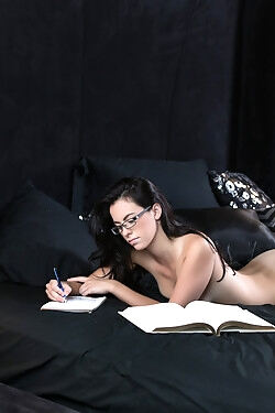 This pretty girl takes a break from studying to play with her juicy pussy
